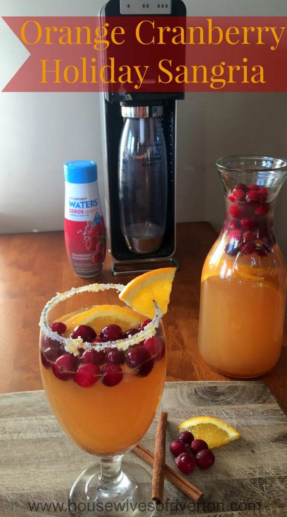 Orange Cranberry Holiday Sangria is a great, non alcoholic drink for the whole family! #ad #WaterMadeExciting | www.housewivesofriverton.com