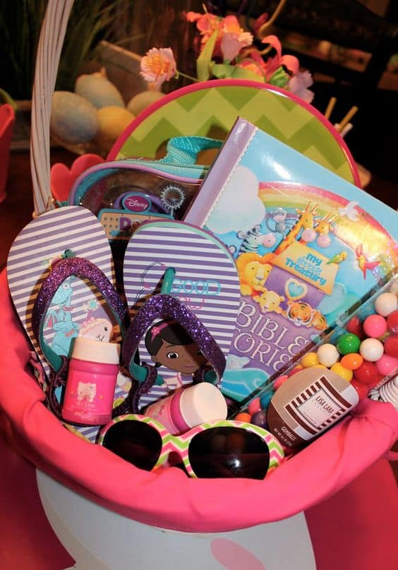 Creative easter basket ideas for babies to teens housewives of heres a basket with cute ideas for a toddler girl i love the idea of doing flip flops and the sunglasses for the warm weather months ahead negle Choice Image
