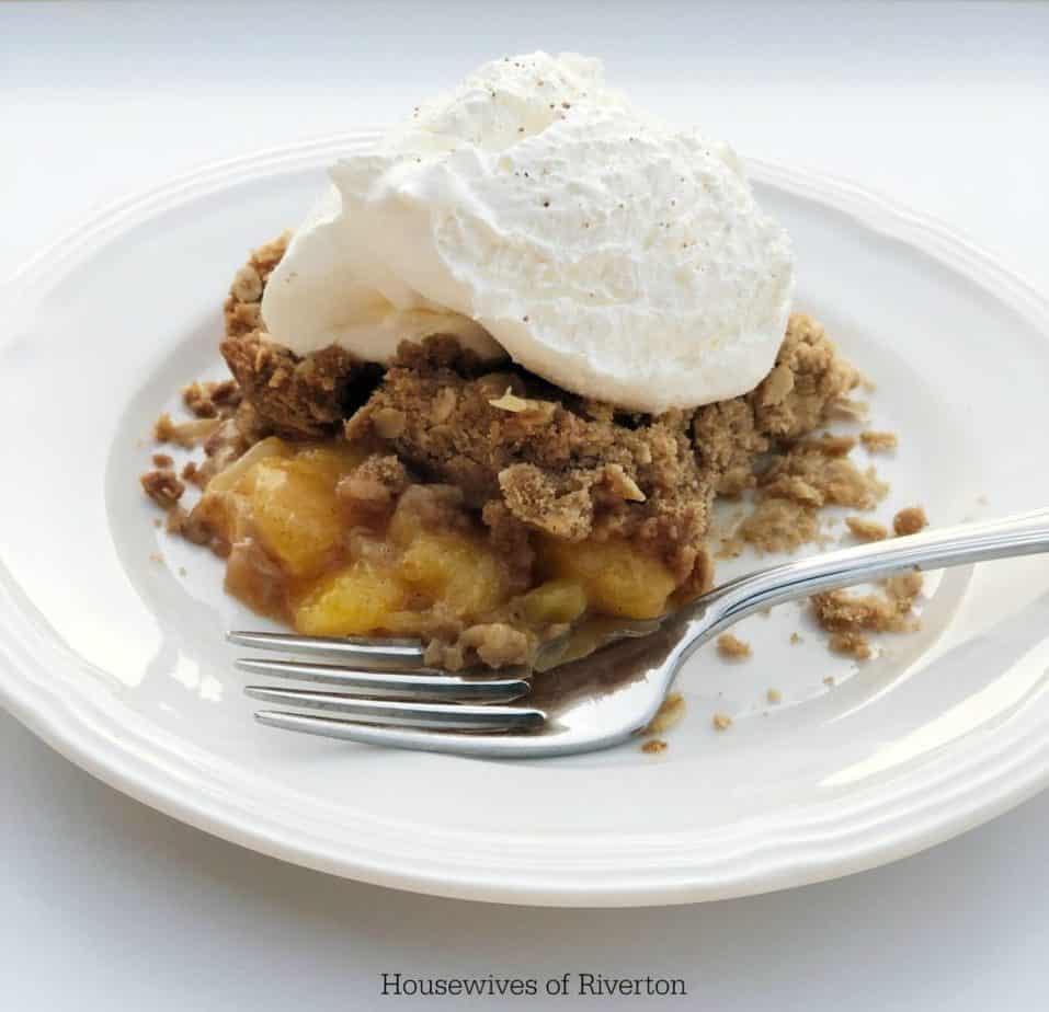Our Fresh Peach Crumble is going to hit the spot for your fall dessert! | www.housewivesofriverton.com